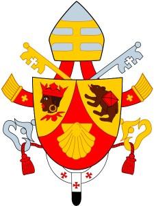 Le blason figurant sur les armoiries papales du pape Benoit XVI sont rendues publiques le 26 avril 2005. Le blason est de type « écu à calice », de gueules chapé d'or. À gauche se trouve le « Maure de Freising », une tête d'Éthiopien couronnée. Au centre, une coquille Saint-Jacques évoque notamment le monastère Saint-Jacques de Ratisbonne et à droite figure «  l'ours de saint Corbinien  ».